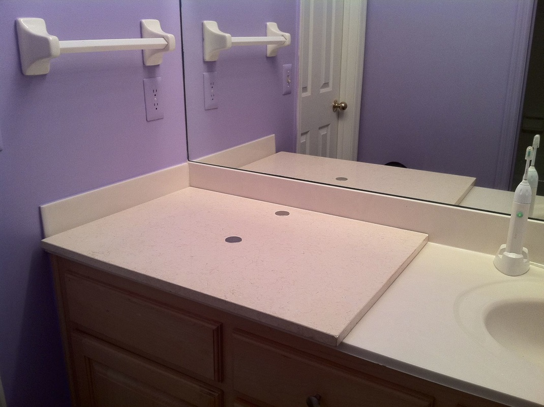 Remove second unused sink, cover with a piece of marble or other material for more counter space. MotherDaughterProjects
