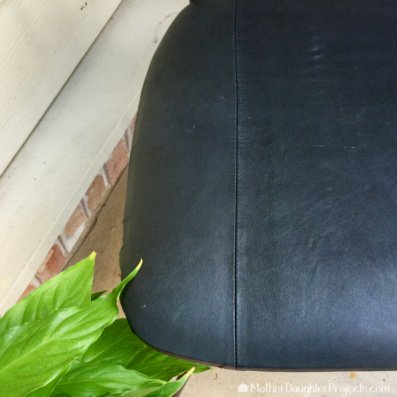 Learn how to upcycle a chair using a thrifted leather skirt!