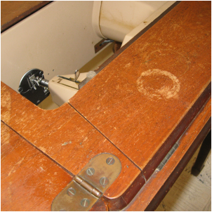 Water damaged from a hurricane, this mid-century Singer Sewing Machine cabinet got a makeover. MotherDaughterProjects.com