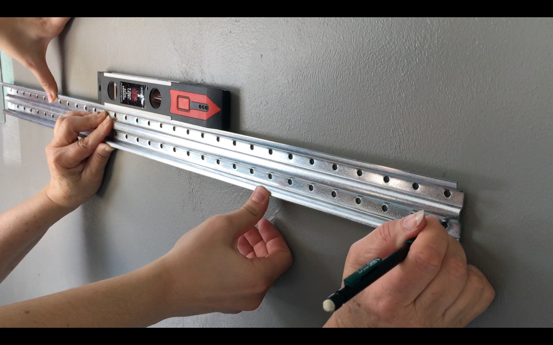 Garage organization with Rubbermaid FastTrack.Line up the tracks using a level & mark. MotherDaughterProjects.com