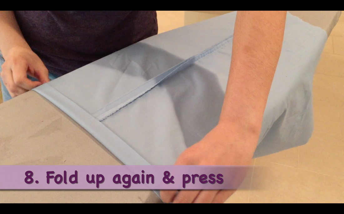 How to Make a Pillowcase Dress: Step 8, fold another 1 inch hem & press. MotherDaughterProjects.com