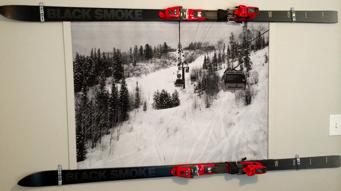 Snow-ski themed guest room with large black & white engineering prints. Low cost/big impact. MotherDaughterProjects.com