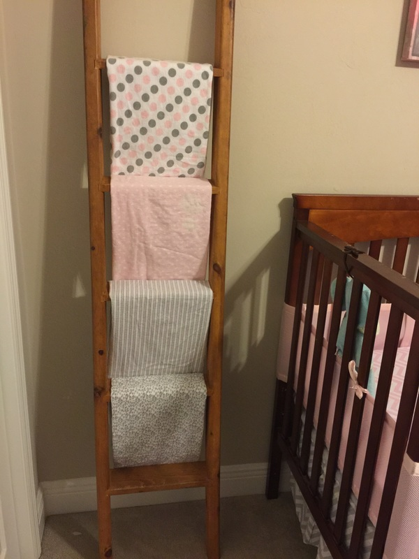 Upcycle ladder from bunkbed to baby blanket holder. MotherDaughterProjects.com