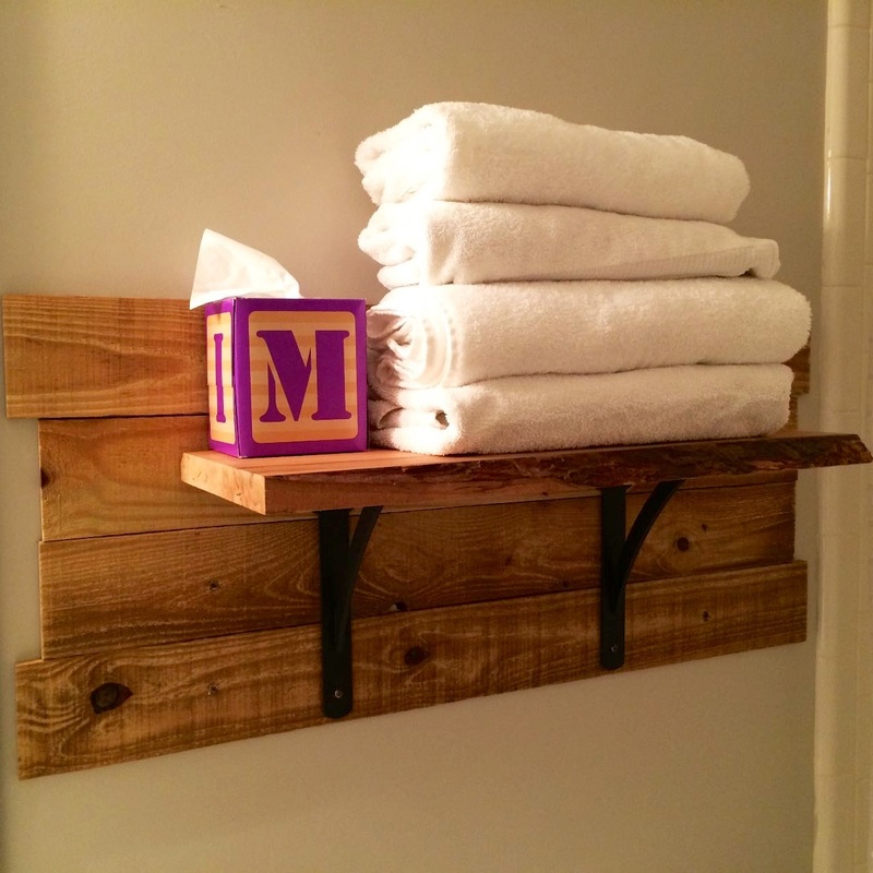 A simple live-edge shelf makes a big statement in a guest bath. MotherDaughterProjects.com