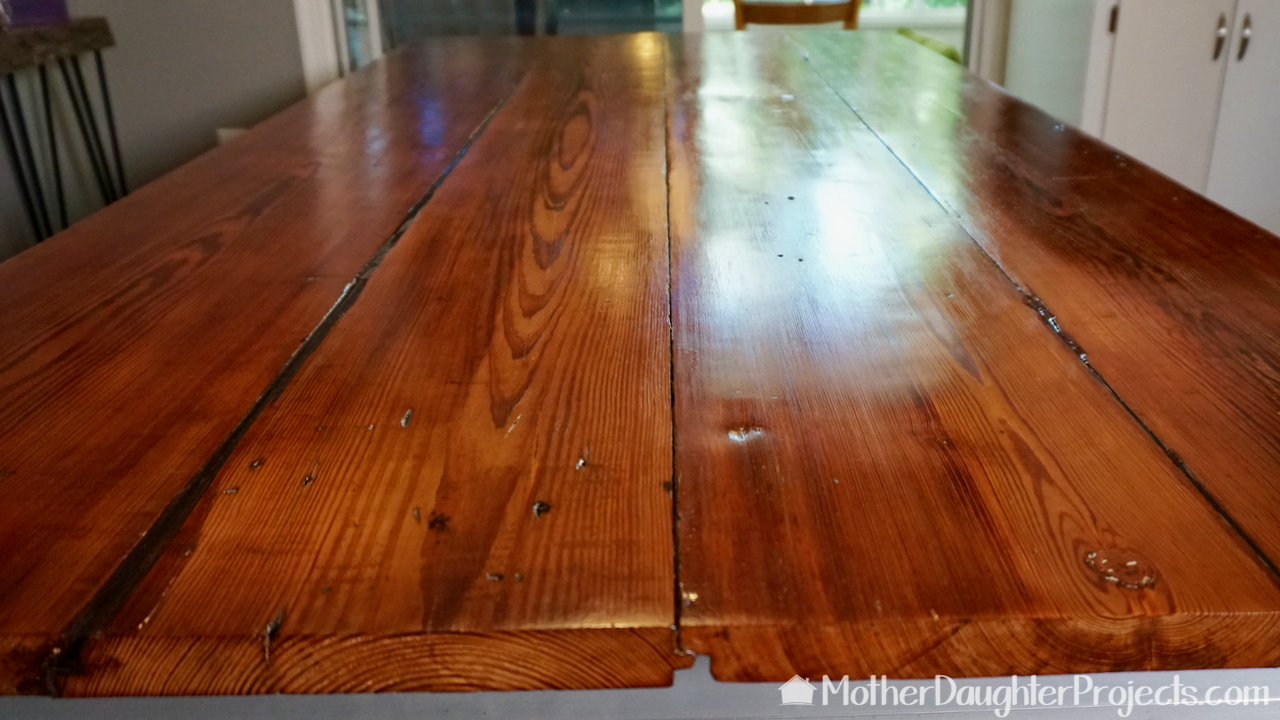 Learn how to refinished a barn wood style dining room table with modern, metal sawhorse legs.