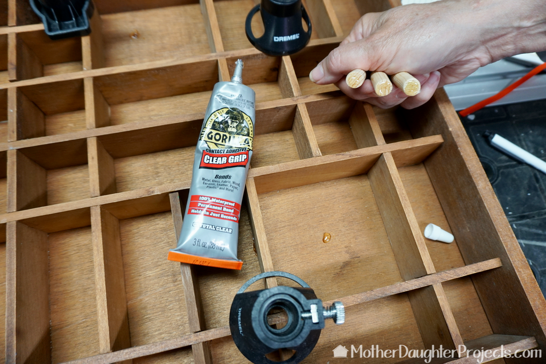 Learn how to take a vintage printer's tray and turn it into storage for small knick knacks, screws, or accessories.