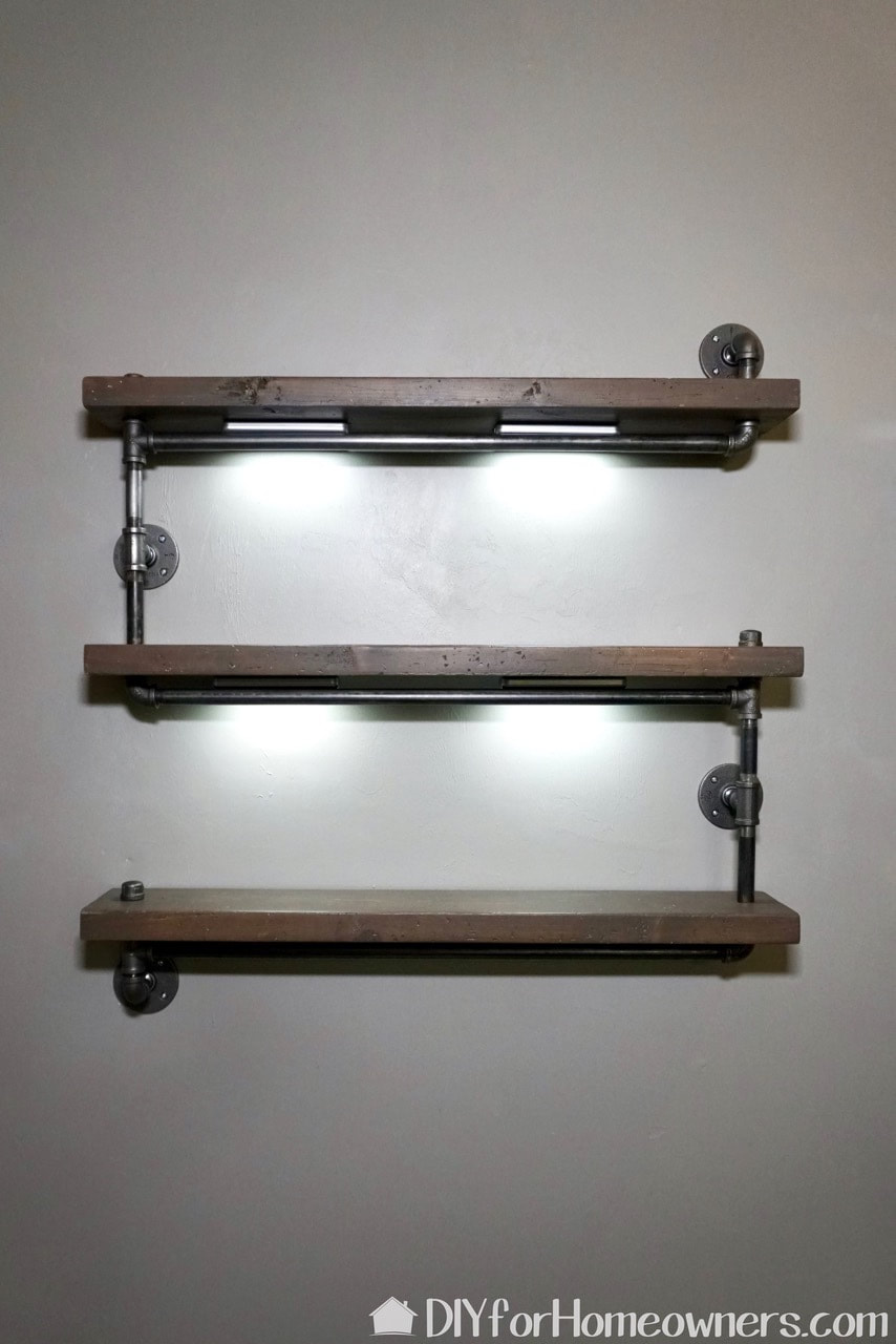 Finished metal pipe and wood diy industrial hanging bookshelf.