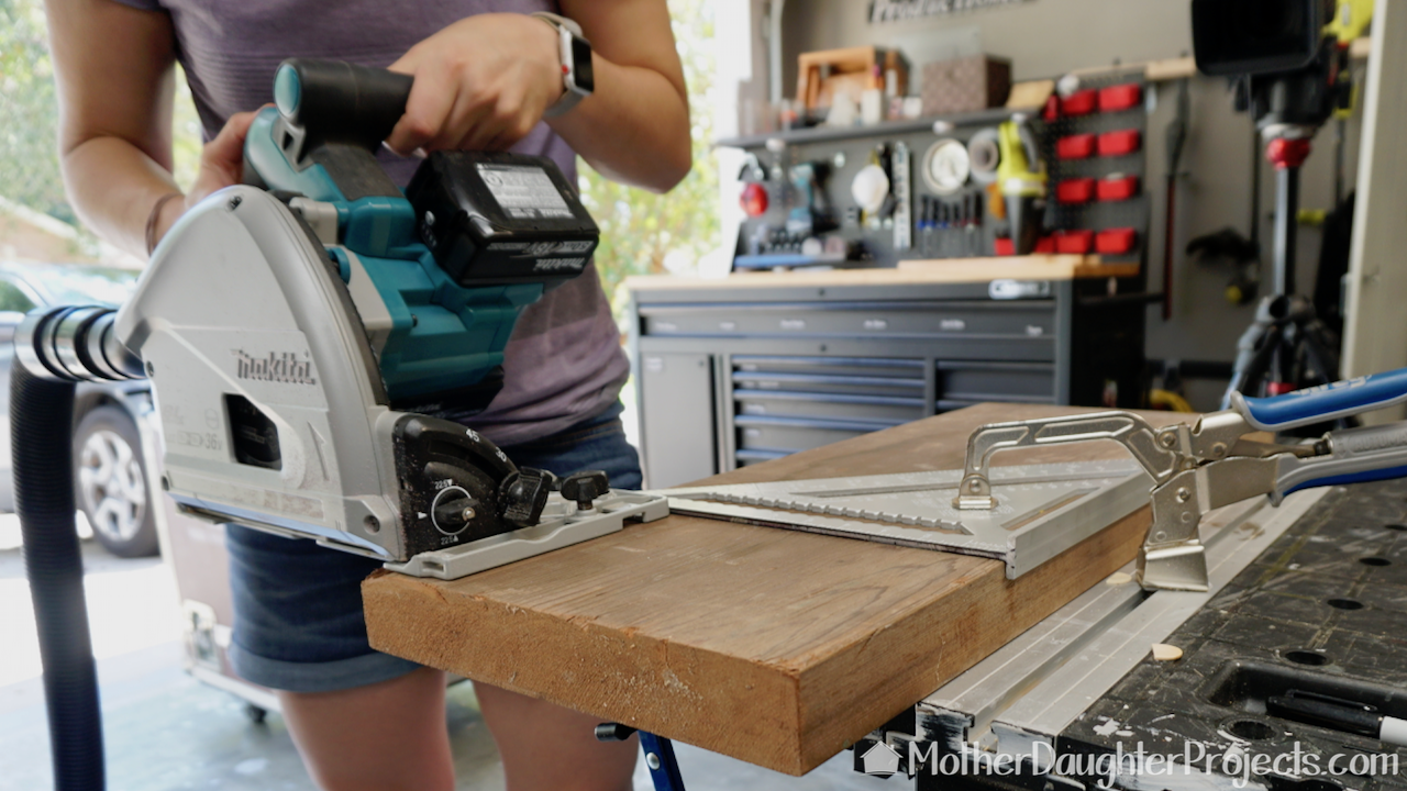 Cutting the board with the Makita track saw.