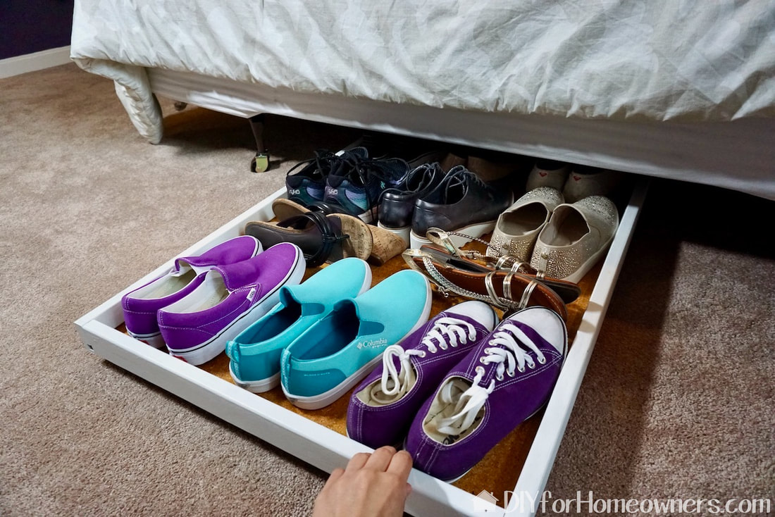 The under-the-bed roll out shoe storage here is holding almost a dozen pairs of shoes! It rolls easily in and out.