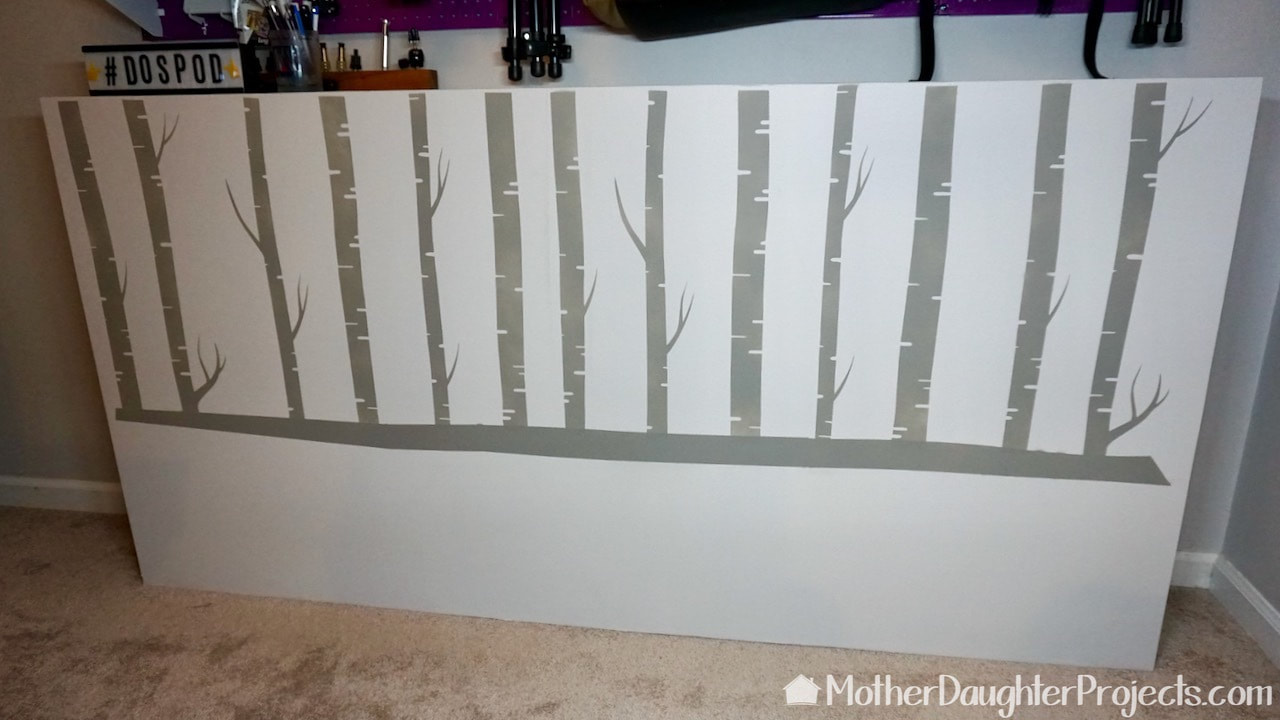 The after of the nature inspired chalk painted stenciled birch trees.