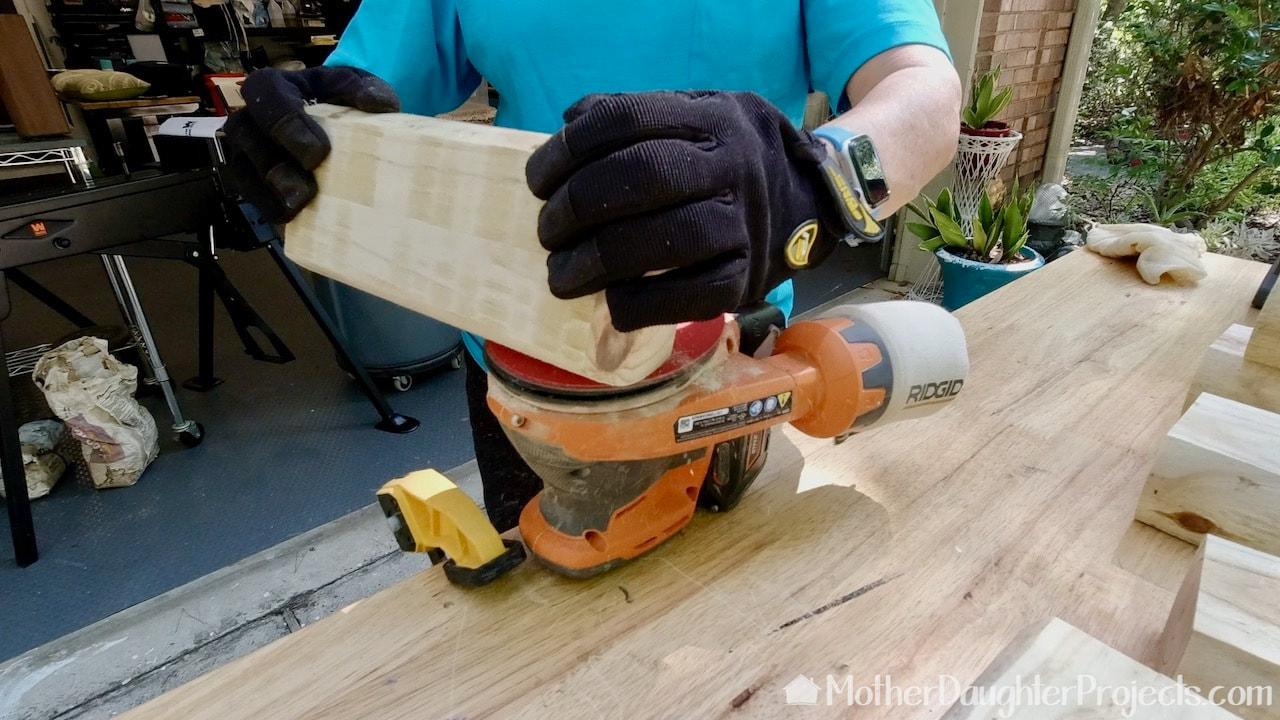 Using a Ridgid battery powered sander.