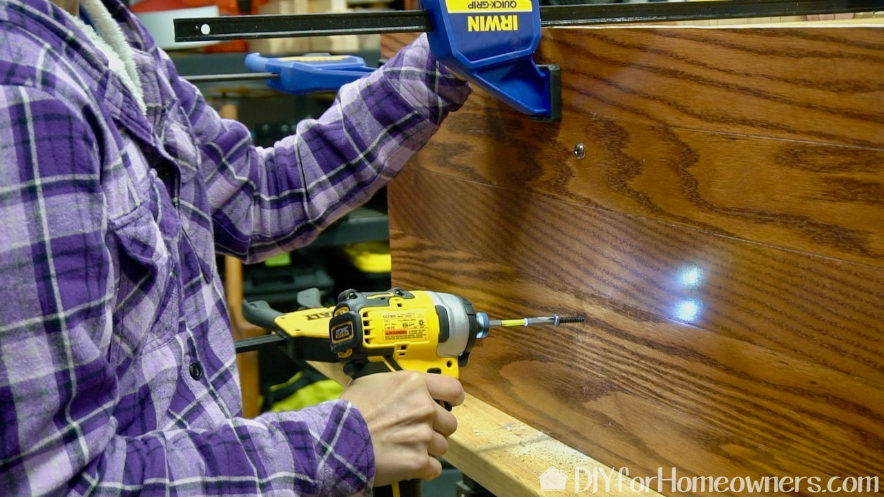 Using the DeWalt Atomic compact impact driver.