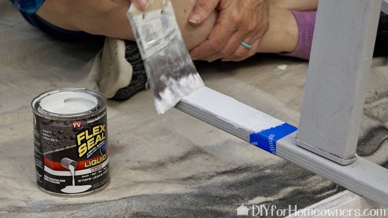 Painting the ladder legs with Flex Seal.