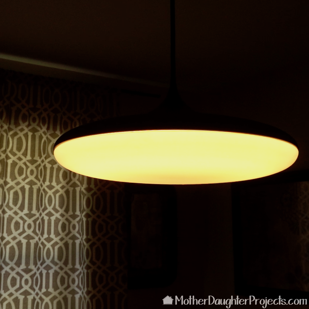 The Philips Hue pendant with warm white light selected.