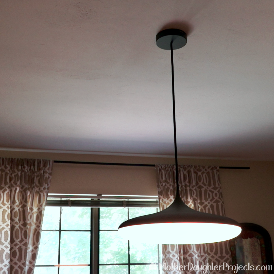 The Phillips Hue pendant can be programed to automatically off and on.