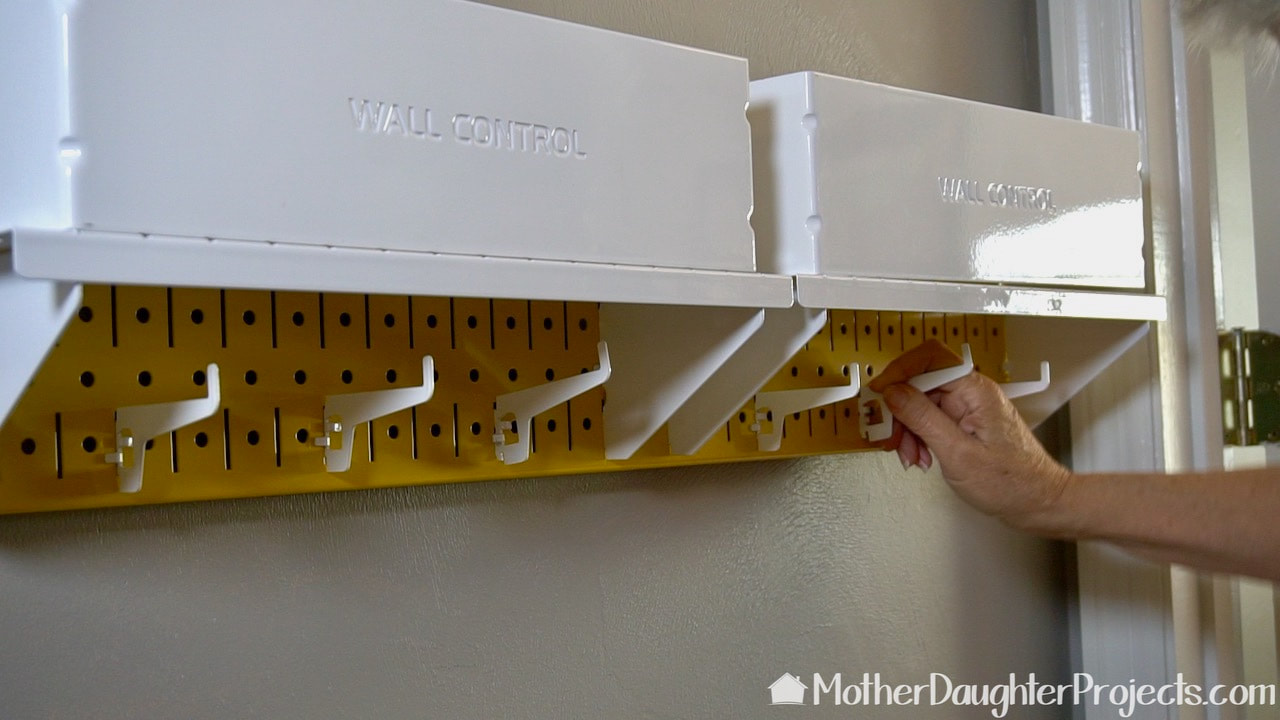 Add the metal Wall Control pegs in the configuration that best fits your family.