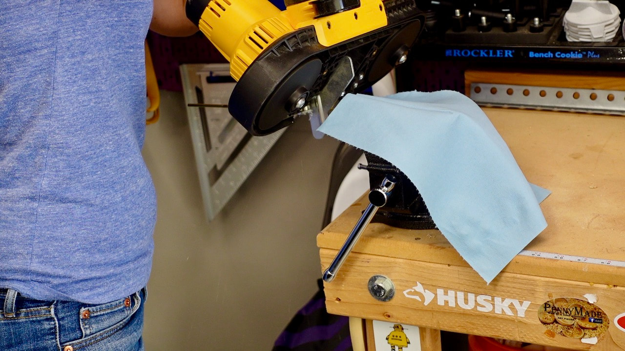 Cutting the brass with a DeWalt battery powered band saw.