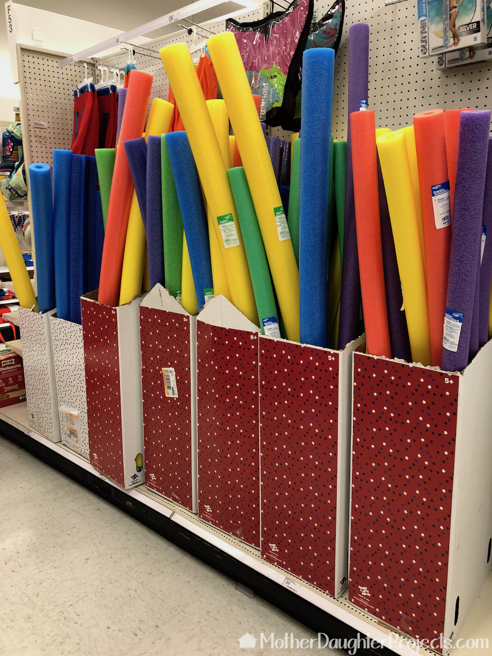The pool noodles in the Target display.