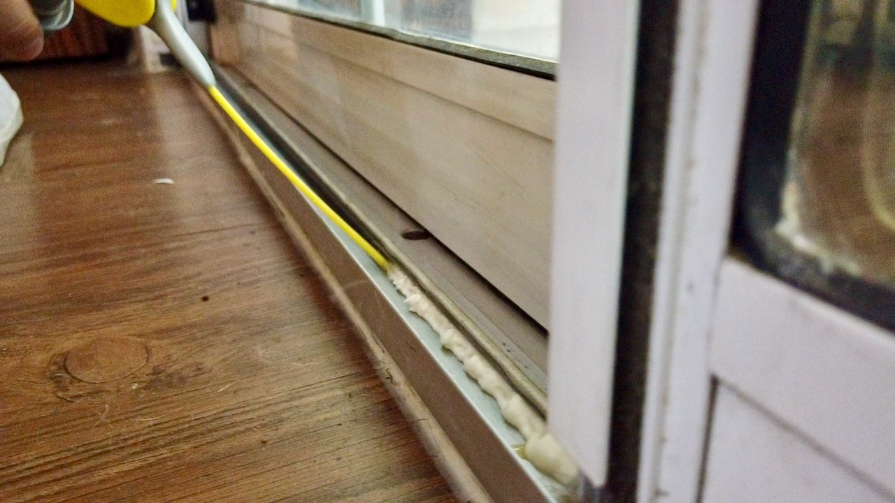 Using WD-40 Specialist spray to lubricate the sliding glass door track.