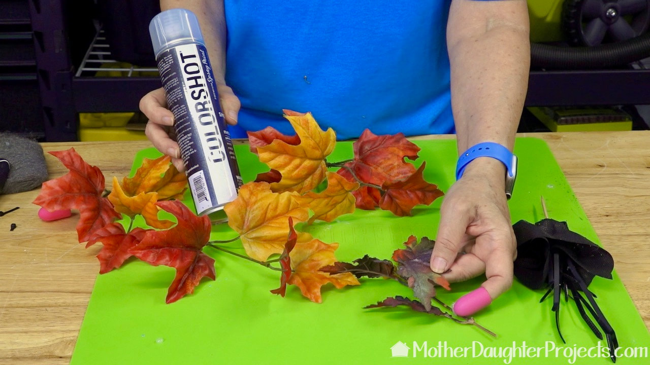 Use fake fall leaves for a little color in your Halloween tree.