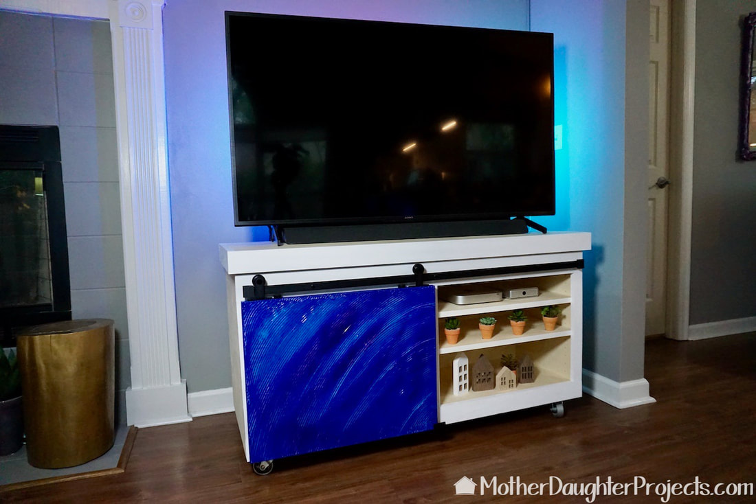 The TV stand in place with colorful sliding door.