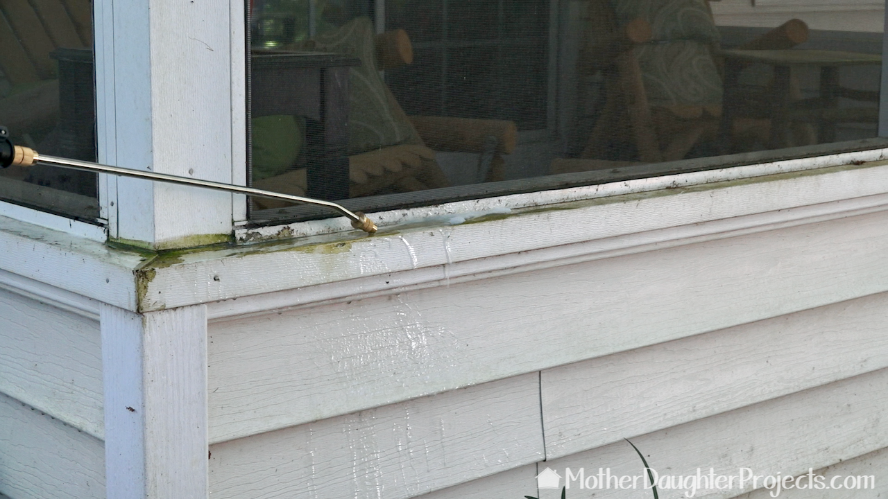 Spraying the green algae on the outside of the porch.
