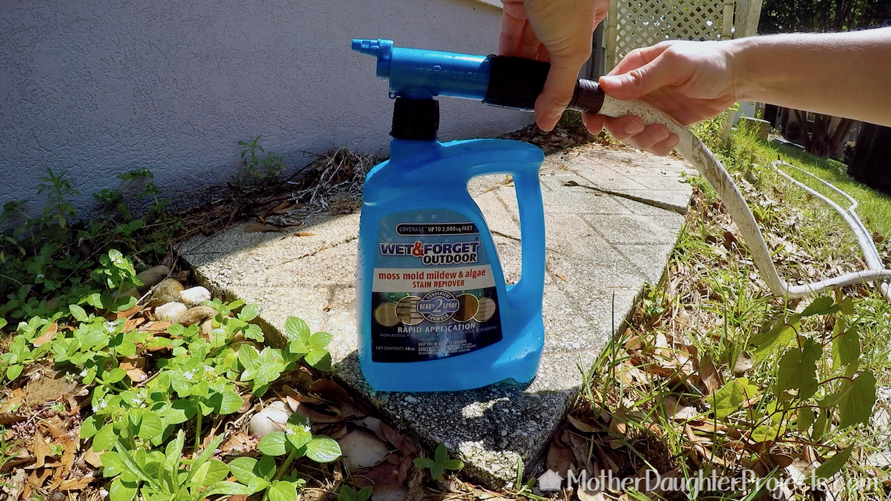 This Wet & Forget attaches to a garden hose.
