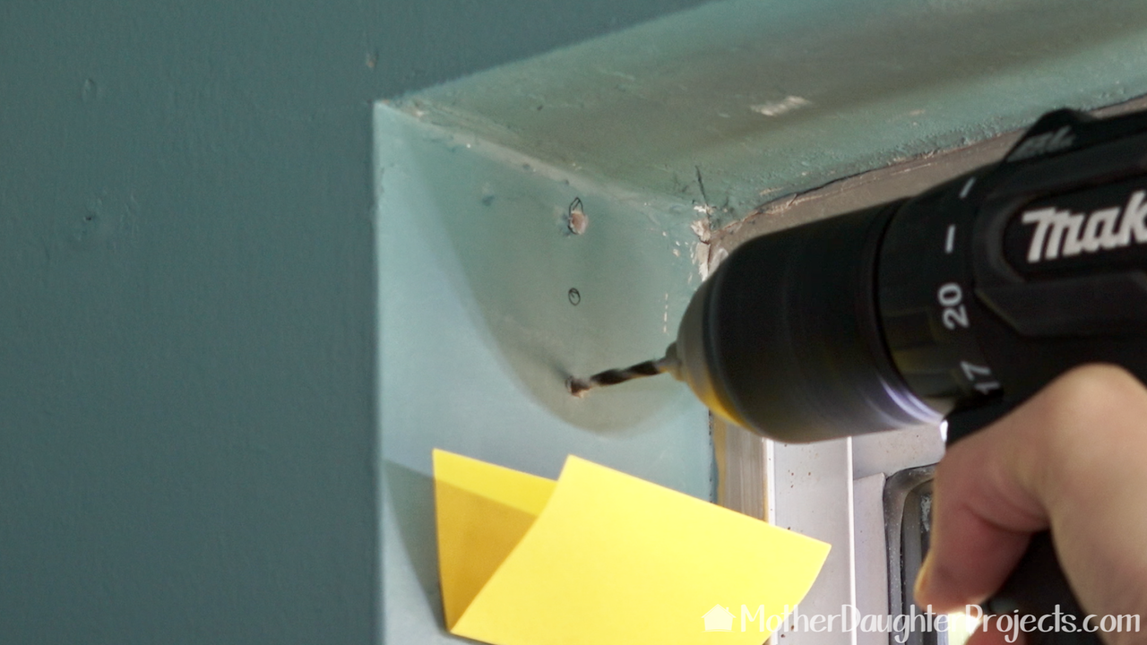 Tip: use a folded Post-It Note to collect the drywall dust as you drill.