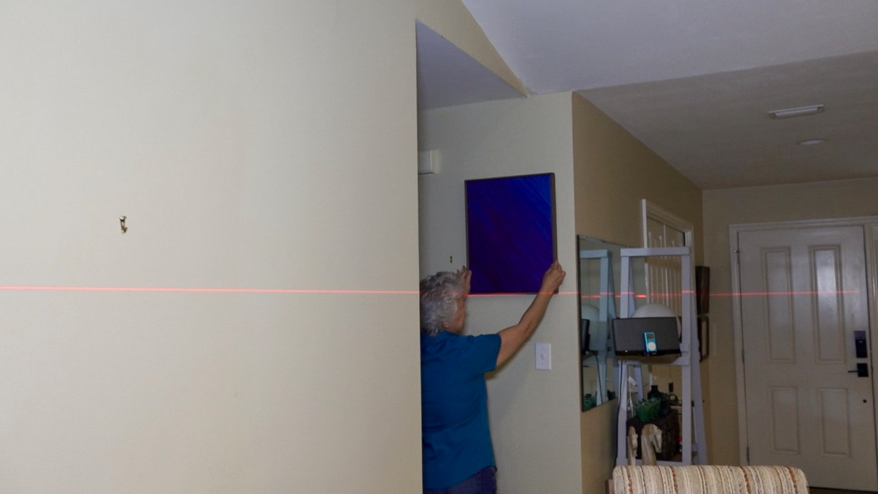 Determine where you want the art to hang and throw a laser line.