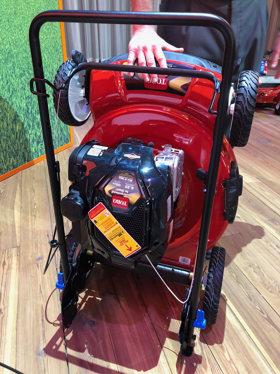Folding Toro lawnmower.