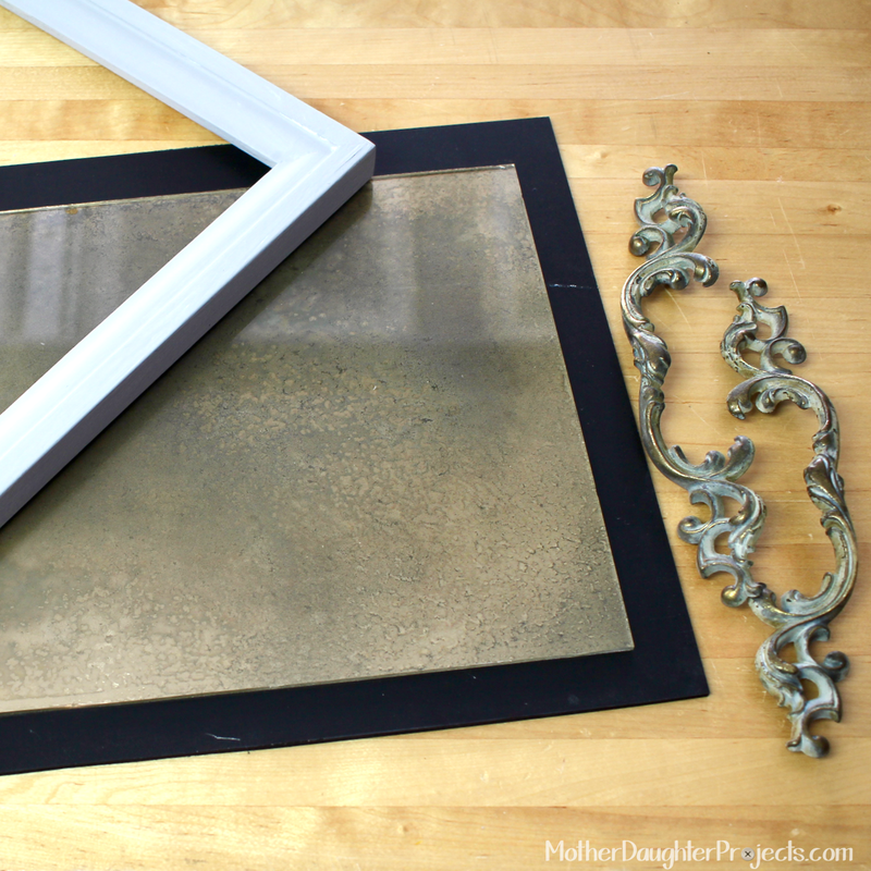 Learn to DIY a vintage look for a tray using an old mirror effect.